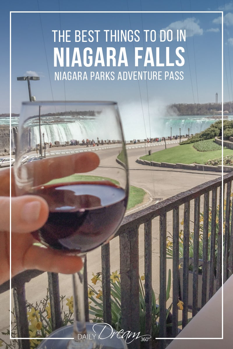 Red wine glass held at Queen Victoria restaurant overlooking Niagara Falls