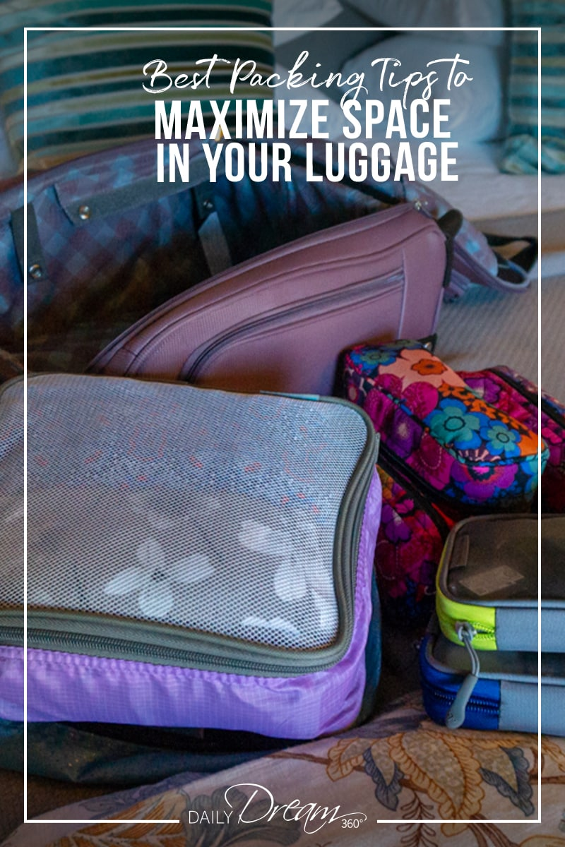 packing cubes and suitcase on bed