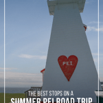 Lighthouse with Welcome to PEI sign next to Confederation Bridge