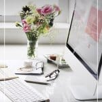 Feminine computer desk with pink flowers and text Tips for Working from Home as a Freelancer or Blogger