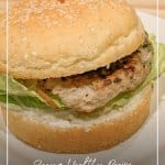 Turkey burger on white plate with text Recipe: Ground Turkey and Zucchini Burgers or Meatballs