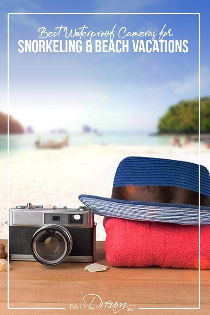 Camera, towel and hat in front of beach