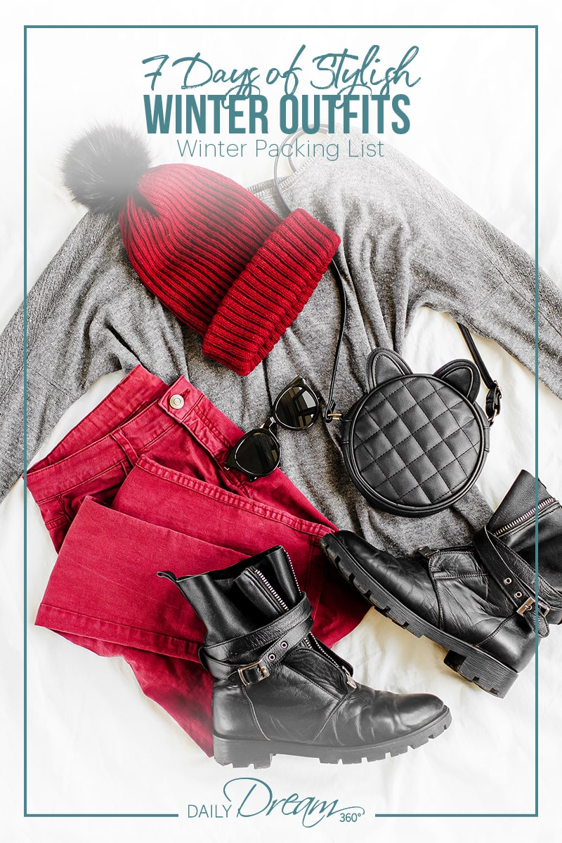 winter clothes laid out on bed