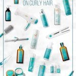 MoroccanOil products laid out on marble background with pin text How to Use MoroccanOil on Curly Hair
