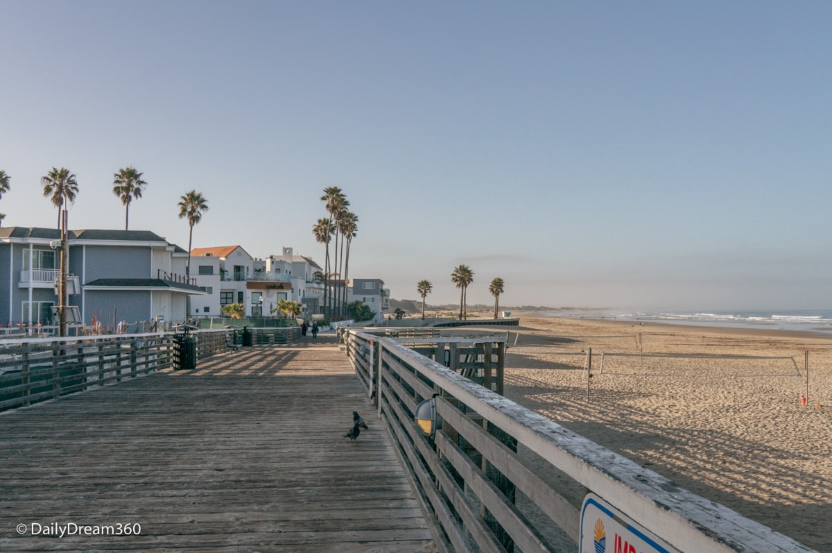 Hotels lined up behind the boardwalk at Pismo Beach California