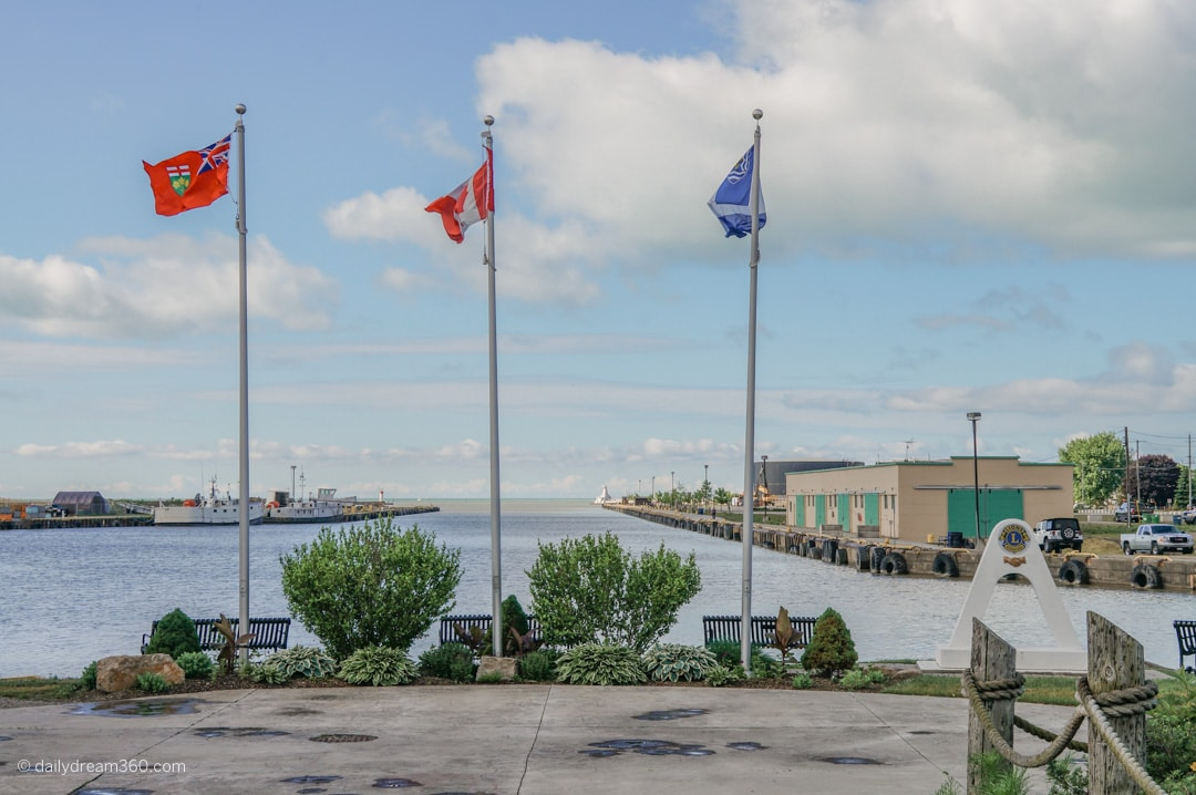 flags overlooking the harbour in Port Stanley Ontario in summer