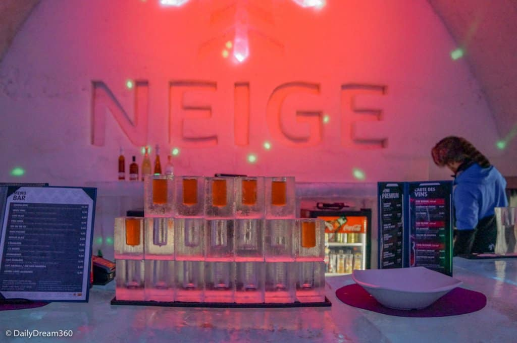 Ice bar with drinks poured in Quebec City Ice Hotel