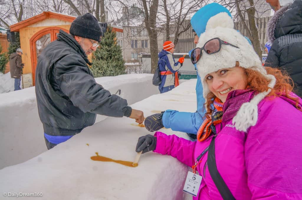 Enjoying frozen Maple Syrup at Quebec Winter Carnival