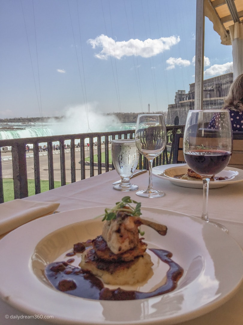 Meal on table overlooking horseshoe falls Queen Victoria Place Restaurant Niagara Falls