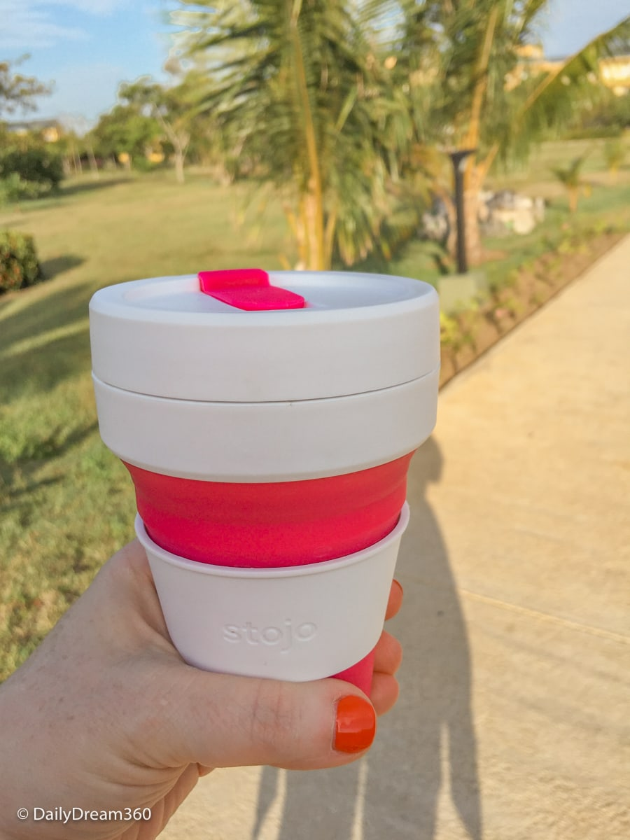 Walking on path in Cuba with stojo pocket cup