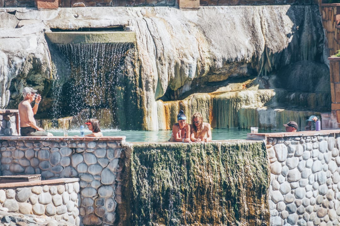 Couple looking out of hot spring in Pagosa Springs Colorado
