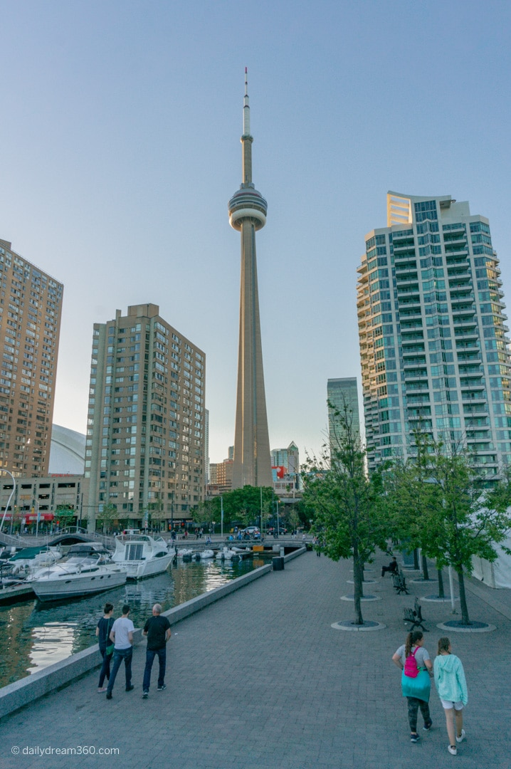 view of CN Tower from Toronto Harbourfront with boats in lake