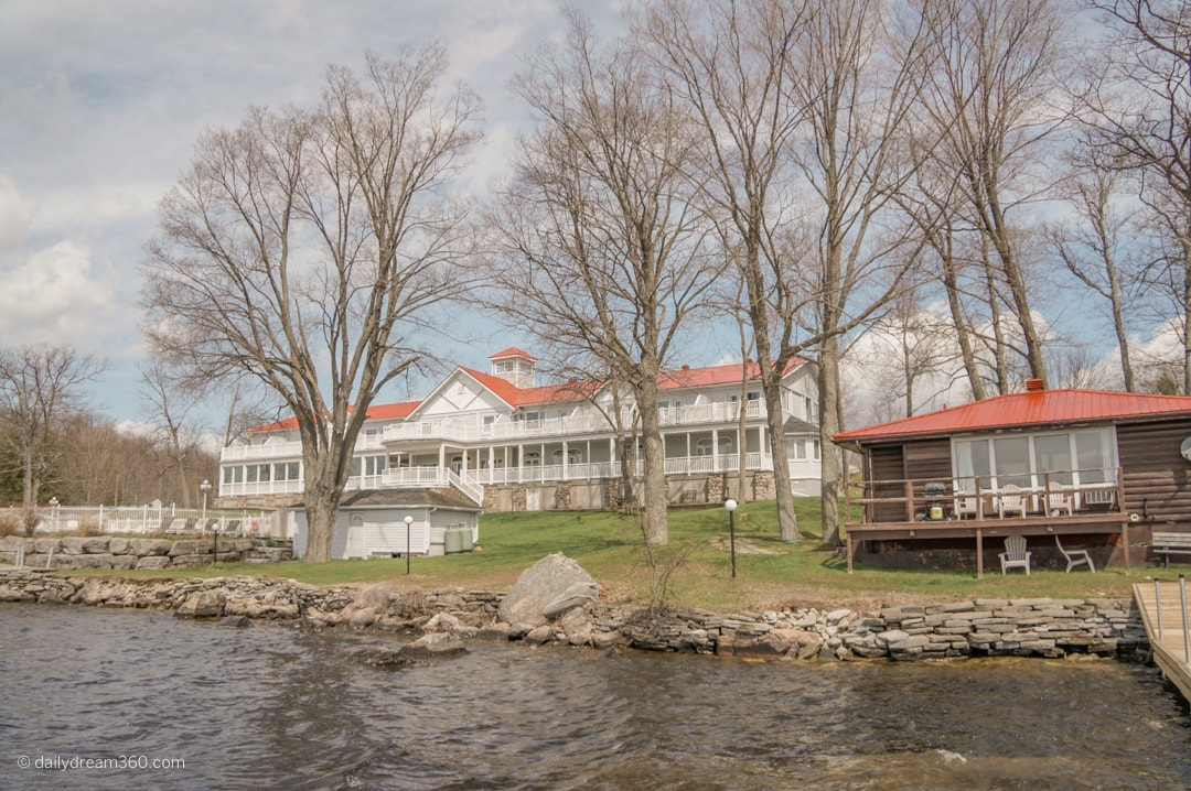 View of Viamede resort from water the main building and a small cottage