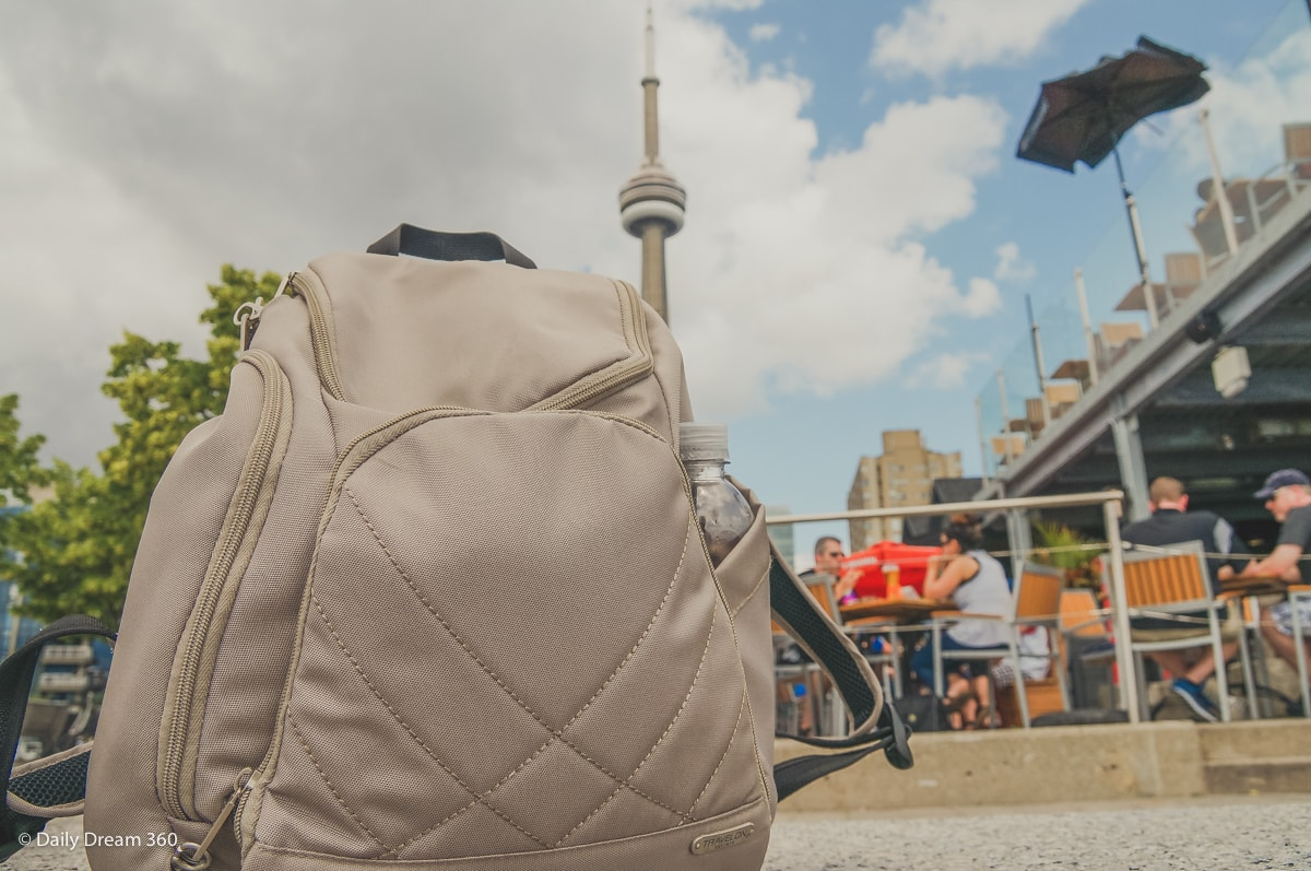 Travelon classic backpack with CN Tower behind