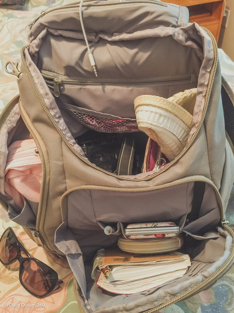 Open compartments in Travelon Anti-theft backpack filled with stuff